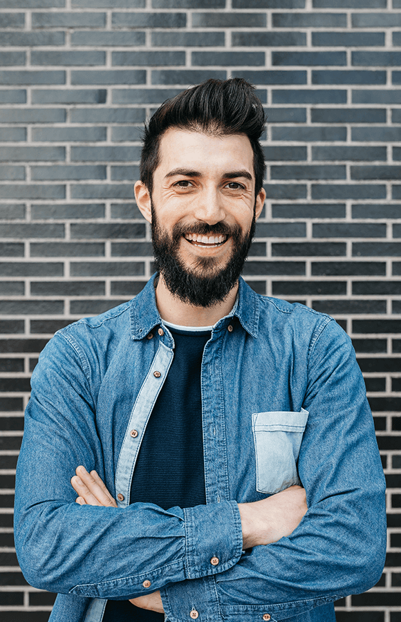 Man crossing arms and smiling