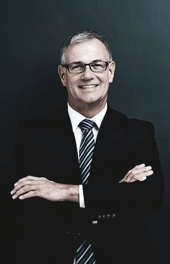 Man in business suit crossing arms and smiling